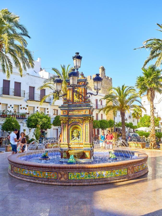 Vejer de la Frontera downtown. Cadiz province, Andalusia, Spain. Vejer de la Frontera, Spain - June 26, 2019. Tiled fountain of the Plaza de Espana square also royalty free stock image