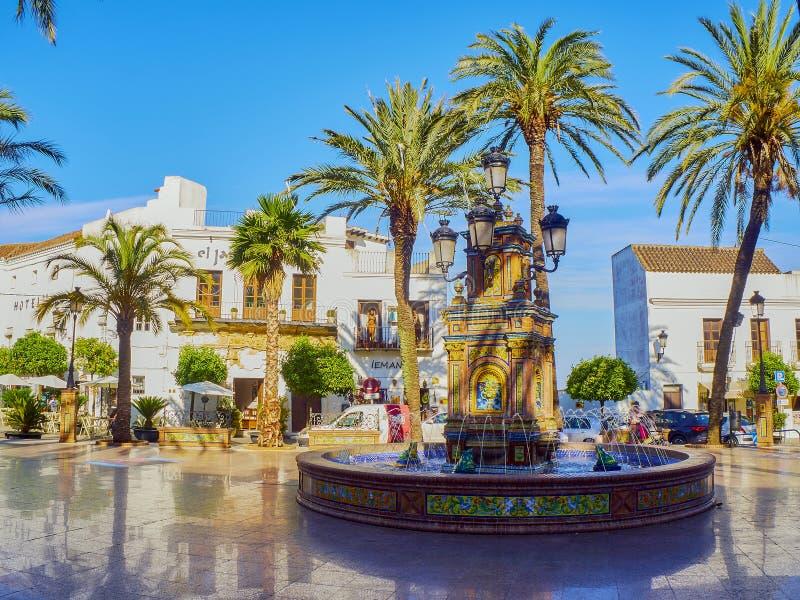Vejer de la Frontera downtown. Cadiz province, Andalusia, Spain. Vejer de la Frontera, Spain - June 26, 2019. Detail of the tiled fountain of the Plaza de Espana royalty free stock photography