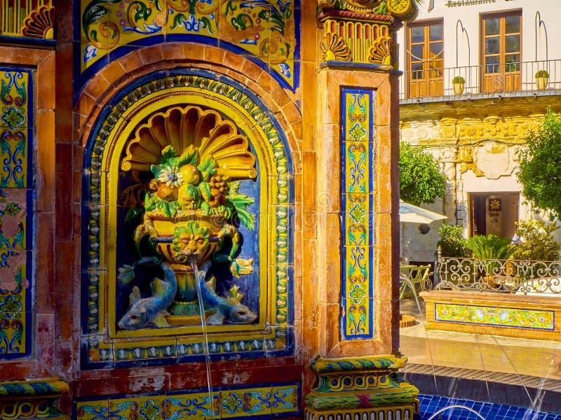 Vejer de la Frontera downtown. Cadiz province, Andalusia, Spain. Vejer de la Frontera, Spain - June 26, 2019. Detail of The tiled fountain of the Plaza de Espana royalty free stock image