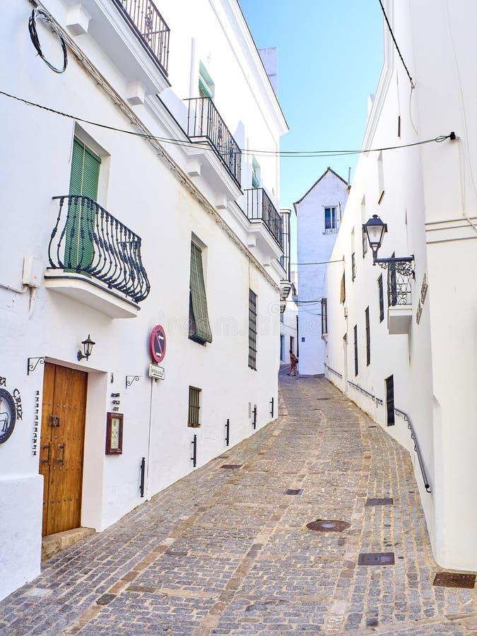 Vejer de la Frontera downtown. Cadiz province, Andalusia, Spain. Vejer de la Frontera, Spain - June 26, 2019. A typical street of whitewashed walls of Vejer de stock images