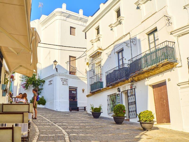 Vejer de la Frontera downtown. Cadiz province, Andalusia, Spain. Vejer de la Frontera, Spain - June 26, 2019. A typical street of whitewashed walls in Vejer de stock photos