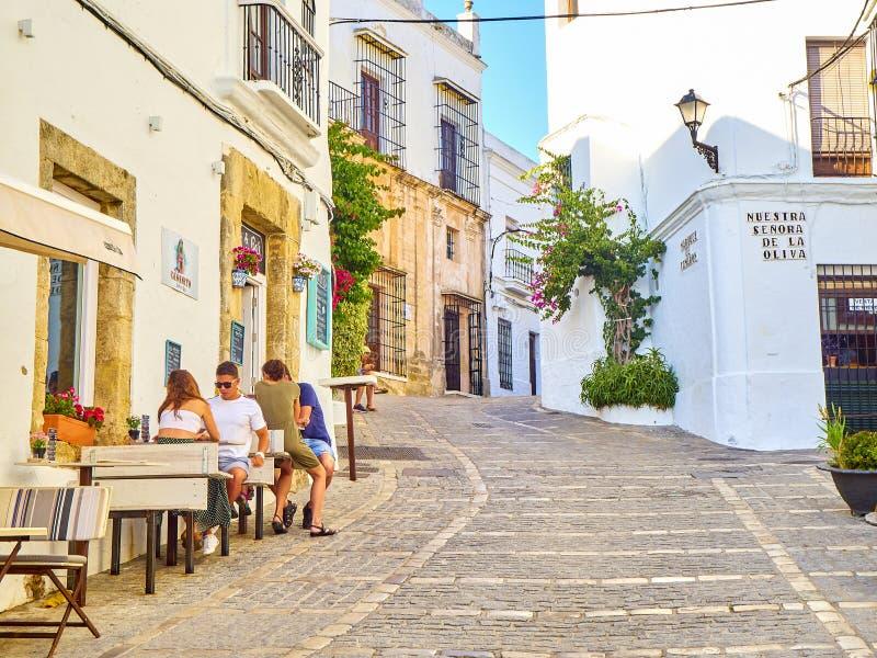 Vejer de la Frontera downtown. Cadiz province, Andalusia, Spain. Vejer de la Frontera, Spain - June 26, 2019. A typical street of whitewashed walls in Vejer de stock images