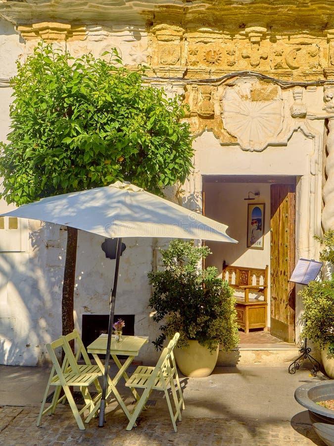Vejer de la Frontera downtown. Cadiz province, Andalusia, Spain. Vejer de la Frontera, Spain - June 26, 2019. A typical street of whitewashed walls in Vejer de stock image