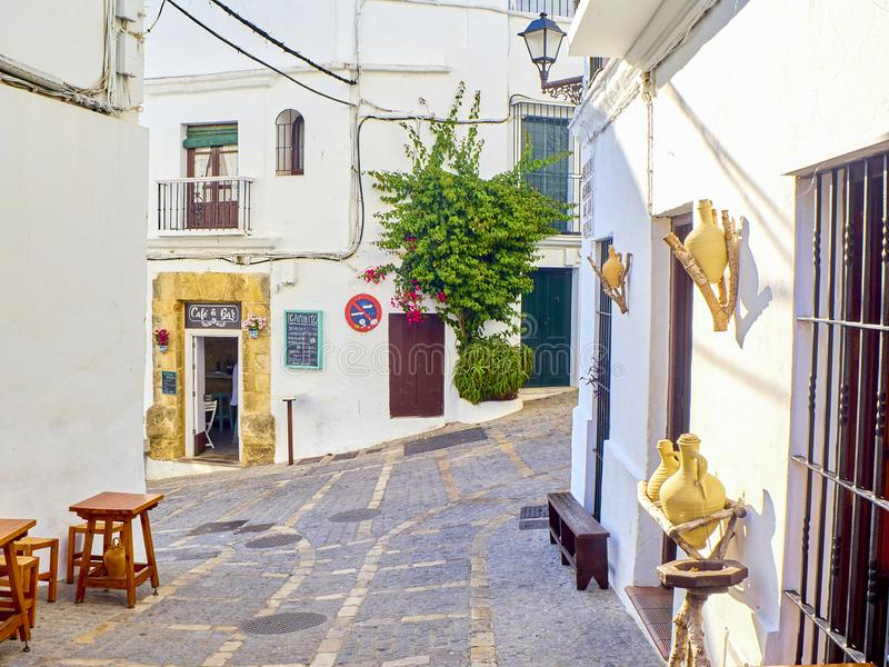 Vejer de la Frontera downtown. Cadiz province, Andalusia, Spain. Vejer de la Frontera, Spain - June 26, 2019. A typical street of whitewashed walls in Vejer de royalty free stock photo