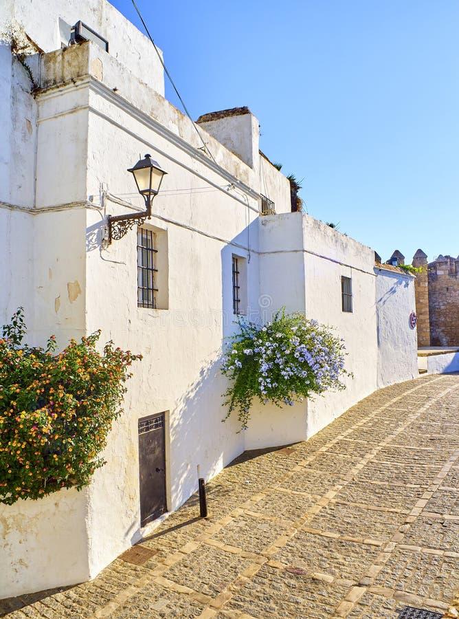 Vejer de la Frontera downtown. Cadiz province, Andalusia, Spain. Marques de Tamaron street, a typical street of whitewashed walls of Vejer de la Frontera royalty free stock photos
