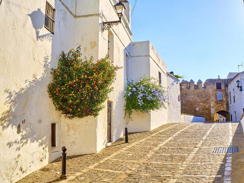 Vejer de la Frontera downtown. Cadiz province, Andalusia, Spain. Marques de Tamaron street, a typical street of whitewashed walls of Vejer de la Frontera royalty free stock images