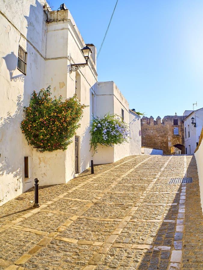 Vejer de la Frontera downtown. Cadiz province, Andalusia, Spain. Marques de Tamaron street, a typical street of whitewashed walls of Vejer de la Frontera stock photography