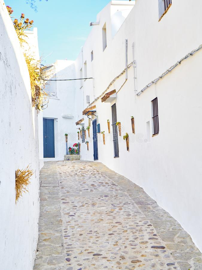 Vejer de la Frontera downtown. Cadiz province, Andalusia, Spain. A typical street of whitewashed walls of Vejer de la Frontera downtown. Cadiz province stock photography