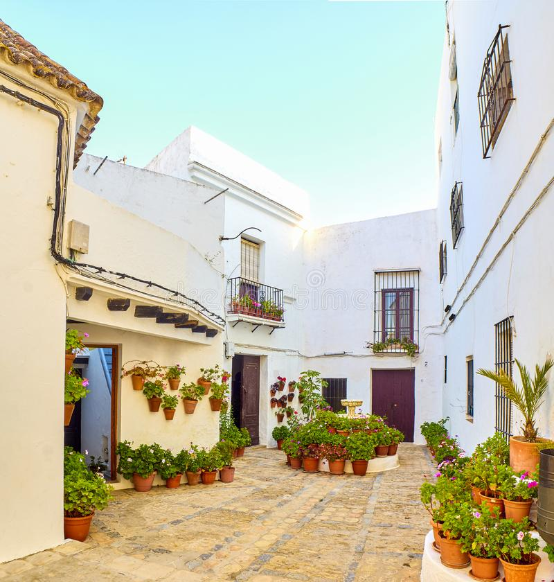 Vejer de la Frontera downtown. Cadiz province, Andalusia, Spain. A typical street of whitewashed walls of Vejer de la Frontera downtown. Cadiz province royalty free stock photography