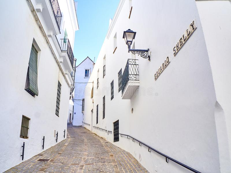 Vejer de la Frontera downtown. Cadiz province, Andalusia, Spain. A typical street of whitewashed walls of Vejer de la Frontera downtown. Eduardo Shelly street royalty free stock images