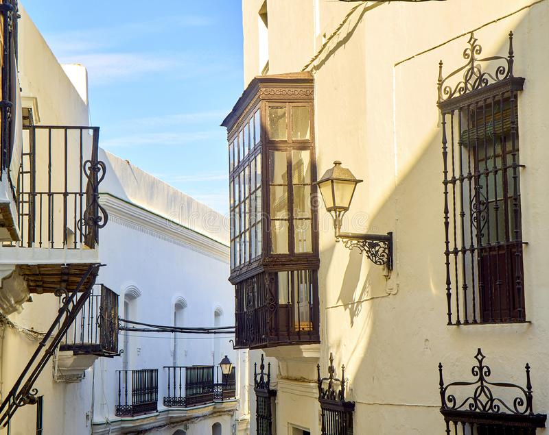 Vejer de la Frontera downtown. Cadiz province, Andalusia, Spain. A typical street with whitewashed walls of Vejer de la Frontera downtown. Jose Castrillon street royalty free stock images