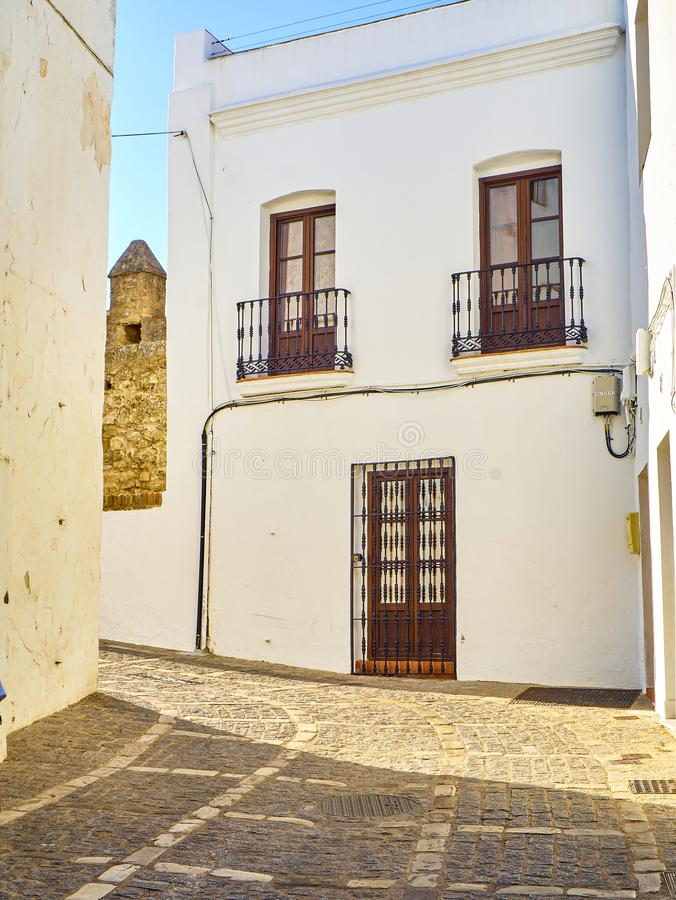 Vejer de la Frontera downtown. Cadiz province, Andalusia, Spain. A typical street with whitewashed walls of Vejer de la Frontera downtown. Jose Castrillon street royalty free stock photo