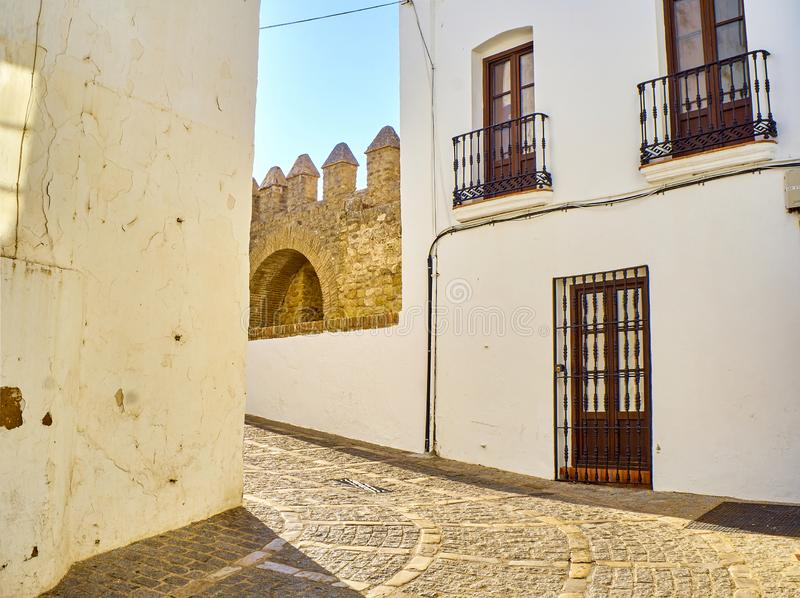 Vejer de la Frontera downtown. Cadiz province, Andalusia, Spain. A typical street of whitewashed walls of Vejer de la Frontera downtown. Jose Castrillon street royalty free stock images