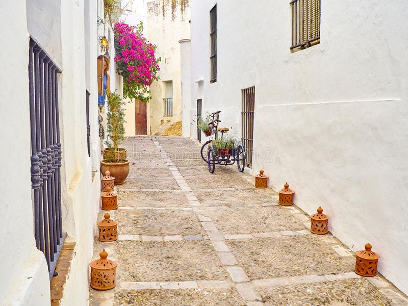 Vejer de la Frontera downtown. Cadiz province, Andalusia, Spain. A typical street of whitewashed walls of Vejer de la Frontera downtown. Sancho IV el Bravo royalty free stock images