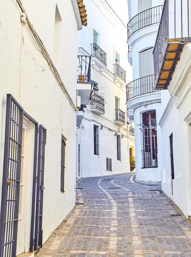 Vejer de la Frontera downtown. Cadiz province, Andalusia, Spain. A typical street with whitewashed walls of Vejer de la Frontera downtown. View from the Jose royalty free stock images