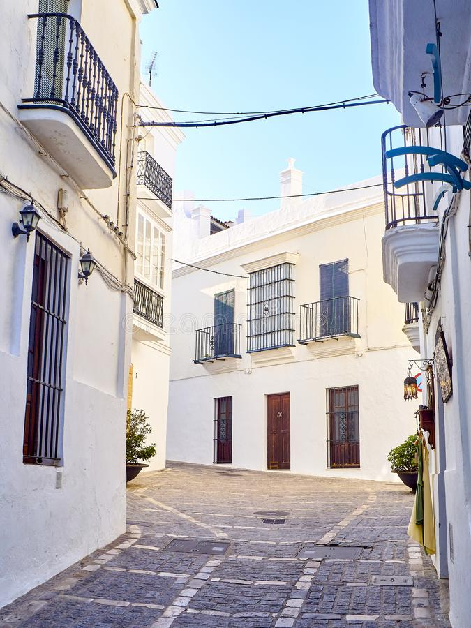 Vejer de la Frontera downtown. Cadiz province, Andalusia, Spain. A typical street with whitewashed walls of Vejer de la Frontera downtown. View from the Jose stock photos