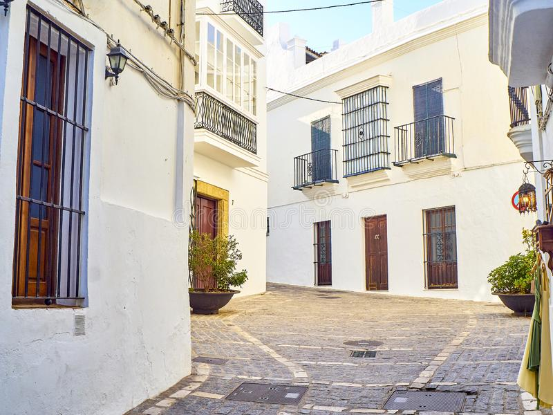 Vejer de la Frontera downtown. Cadiz province, Andalusia, Spain. A typical street with whitewashed walls of Vejer de la Frontera downtown. View from the Jose stock photography