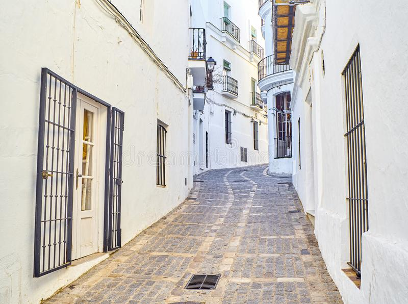 Vejer de la Frontera downtown. Cadiz province, Andalusia, Spain. A typical street of whitewashed walls of Vejer de la Frontera downtown. View from the Jose stock image