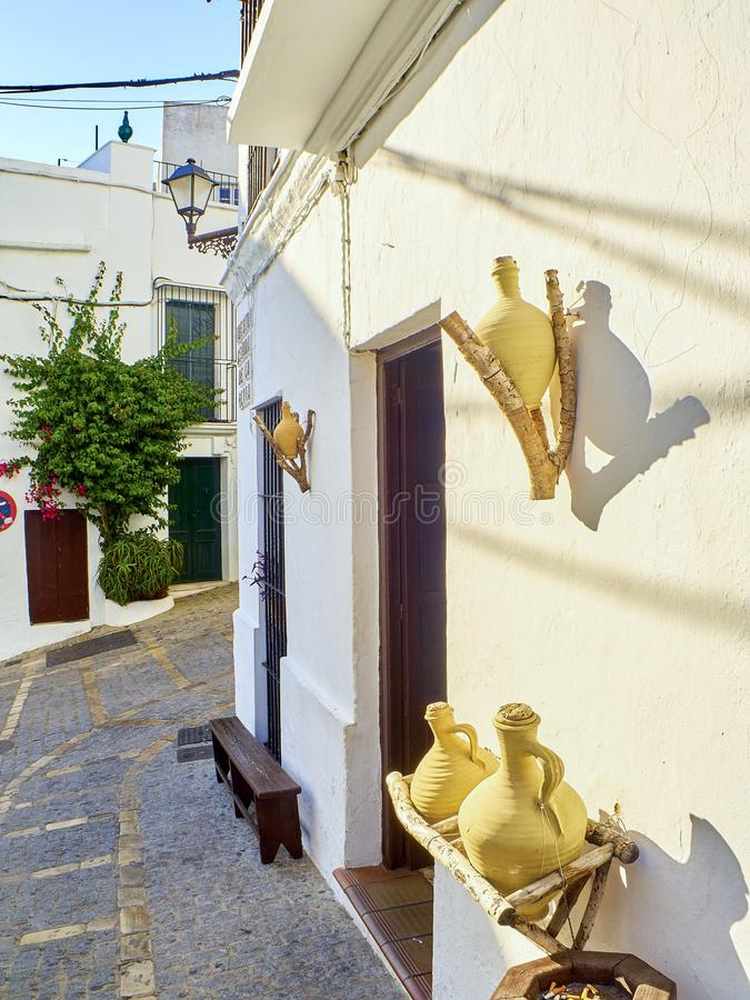 Vejer de la Frontera downtown. Cadiz province, Andalusia, Spain. A typical street of whitewashed walls in Vejer de la Frontera downtown. View from Nuestra Senora stock photo