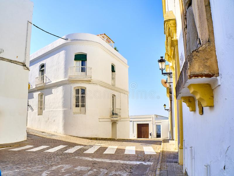 Vejer de la Frontera downtown. Cadiz province, Andalusia, Spain. A typical street of whitewashed walls of Vejer de la Frontera downtown. View from Padre Caro royalty free stock photography