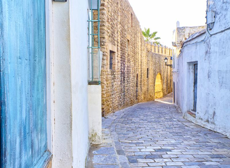 Vejer de la Frontera downtown. Cadiz province, Andalusia, Spain. Walls of Vejer de la Frontera downtown with the Arch of the Closed Door, Arco de la Puerta royalty free stock photos