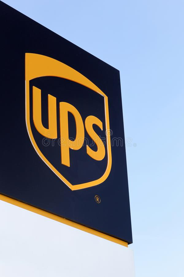 UPS logo on a panel. Vejle, Denmark - September 10, 2016: UPS logo on a panel. United Parcel Service is the worlds largest package delivery company and a royalty free stock image