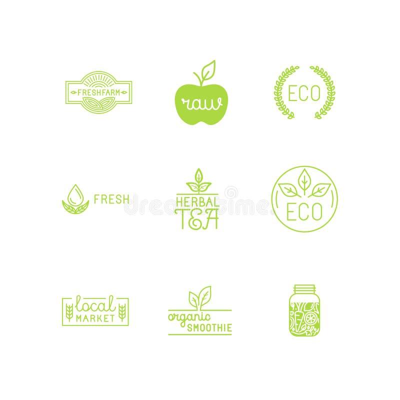 Vektoruppsättningen av gröna och organiska produkter märker och förser med märke vektor illustrationer