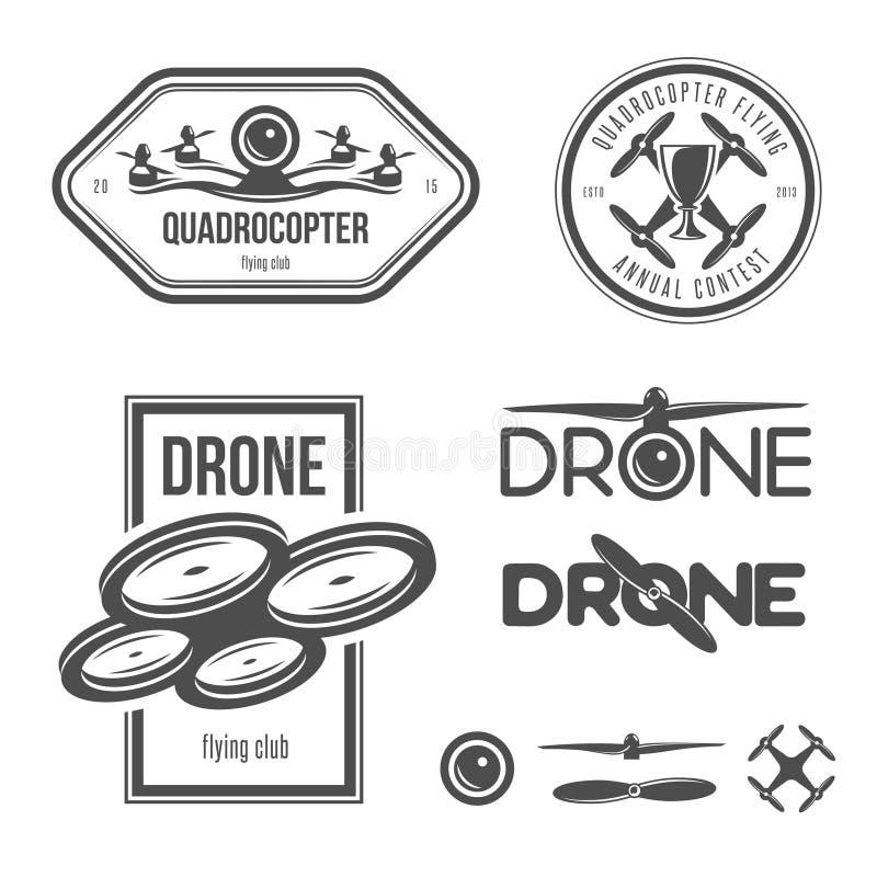 Vektoruppsättningen av surrflygklubban märker, förser med märke stock illustrationer
