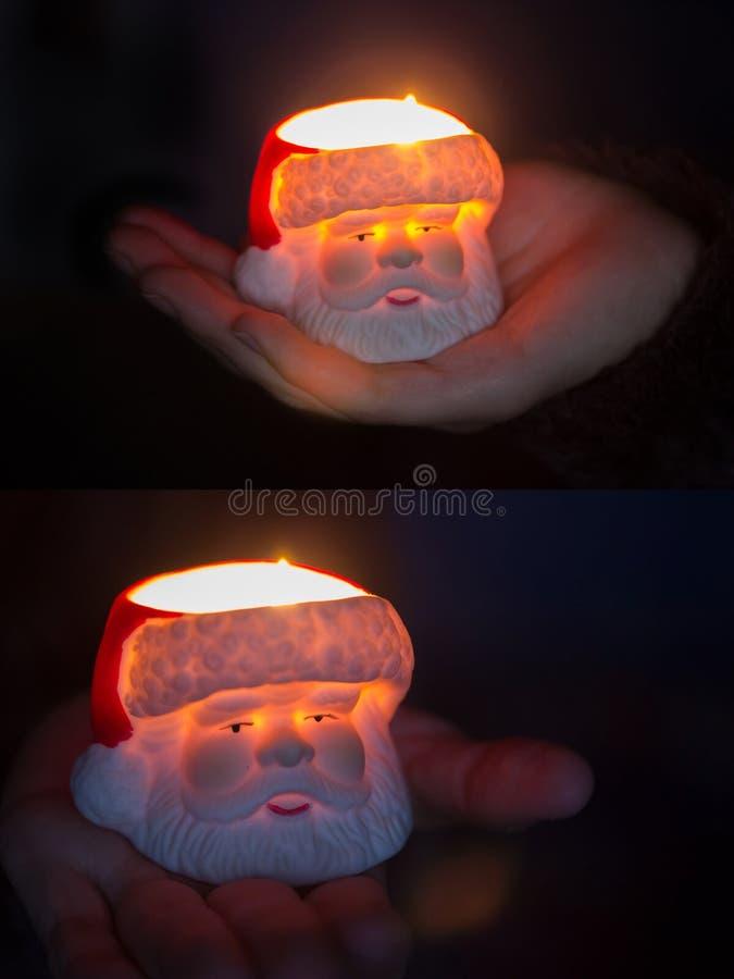 Vela ardiente con Santa Claus a disposición imagenes de archivo