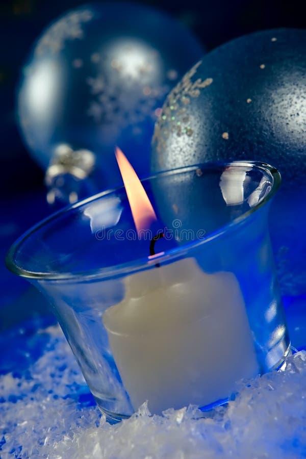 Vela de la magia de la Navidad imagenes de archivo
