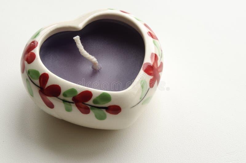 Vela decorativa na forma de um coração foto de stock royalty free