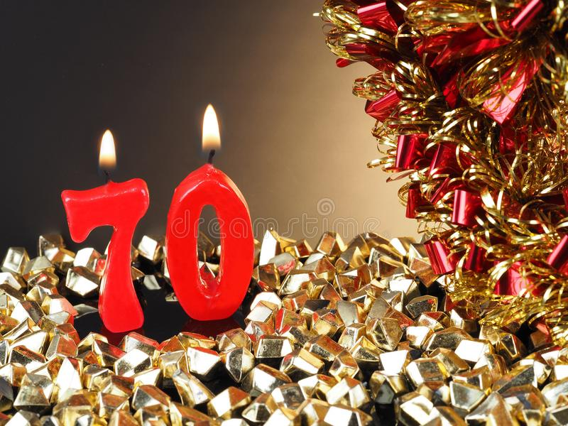 vela do Aniversário-aniversário que mostra Nr 70 imagens de stock royalty free