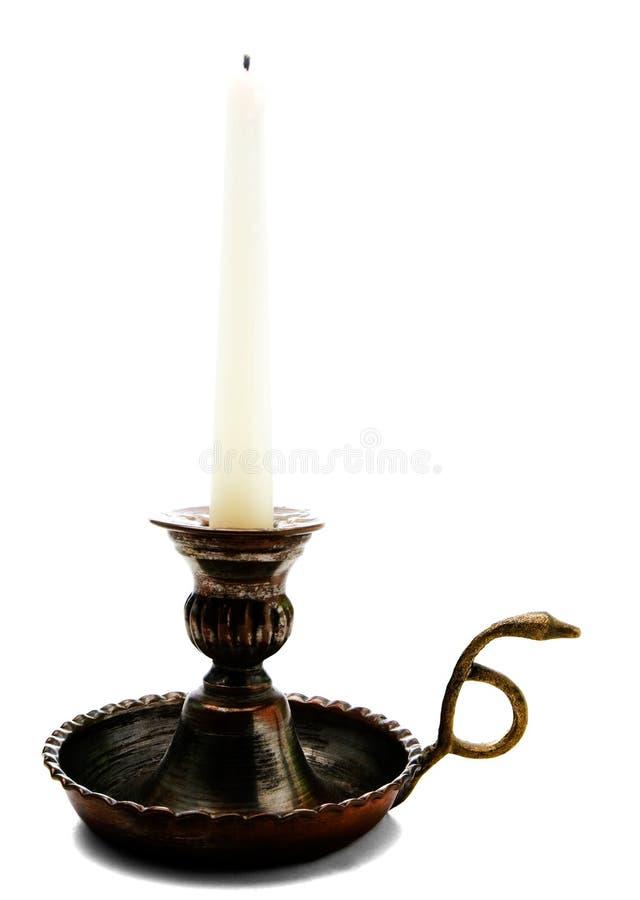 Vela en sostenedor del palillo de la vela fotografía de archivo libre de regalías