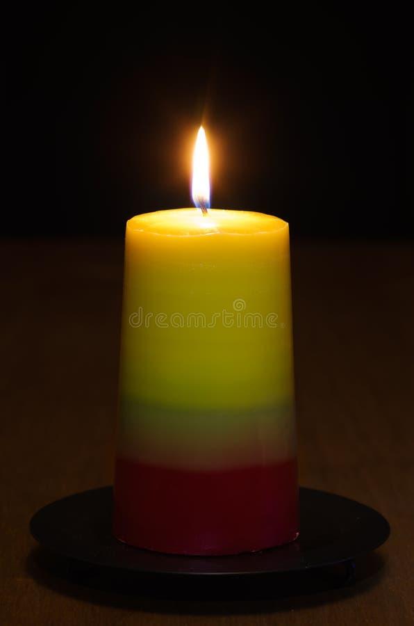 A vela iluminou-se na obscuridade - craft a série das velas fotografia de stock royalty free