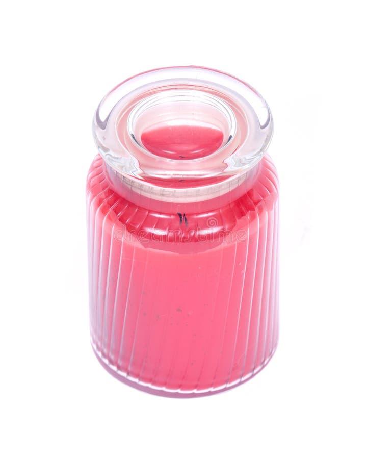 Vela scented vermelha no frasco fotografia de stock royalty free