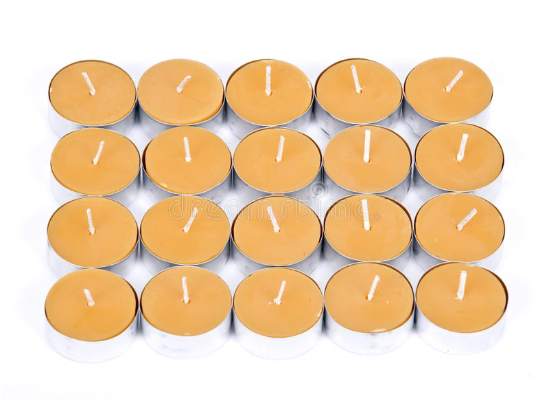 20 velas amarillas imagen de archivo libre de regalías