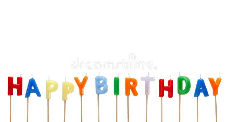 Velas coloridas de la torta del feliz cumpleaños fotografía de archivo