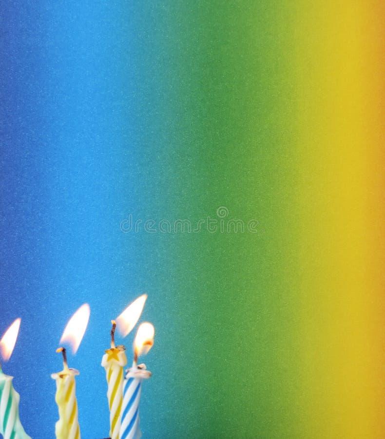 Velas coloridas no verde amarelo e no azul fotos de stock royalty free