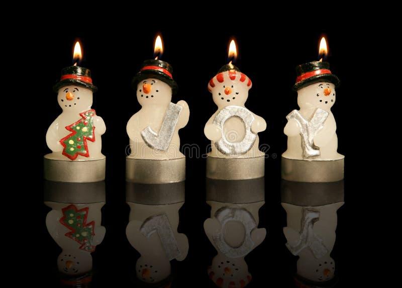 Velas de los muñecos de nieve fotos de archivo