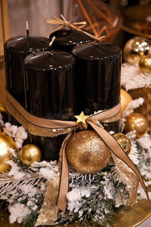 Velas do Natal do preto e do ouro imagem de stock royalty free