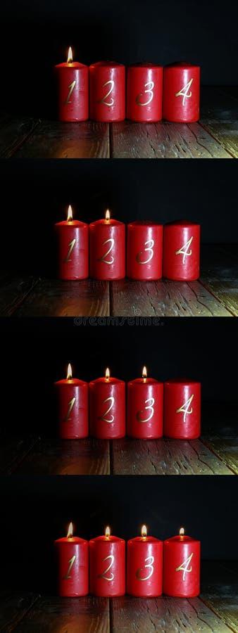 Velas Red Advent ficam sobre um chão de madeira foto de stock royalty free
