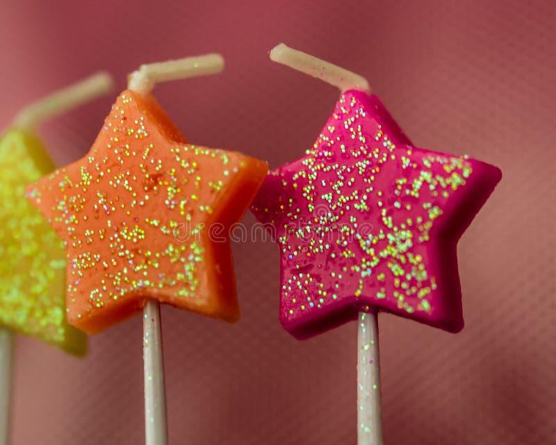 Velas Sparkly Glittery da estrela do close-up imagens de stock royalty free