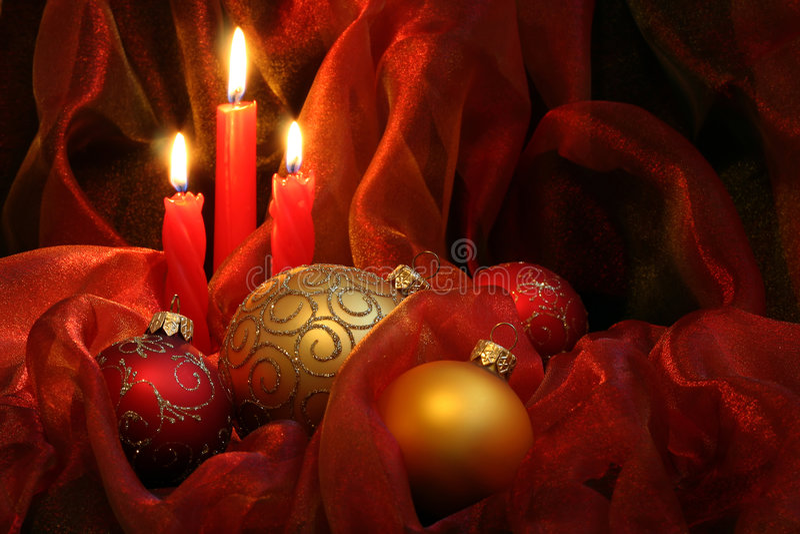 Velas y chucherías de la Navidad foto de archivo
