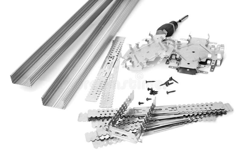 Vele componenten voor installatie van gipspanelen stock afbeelding