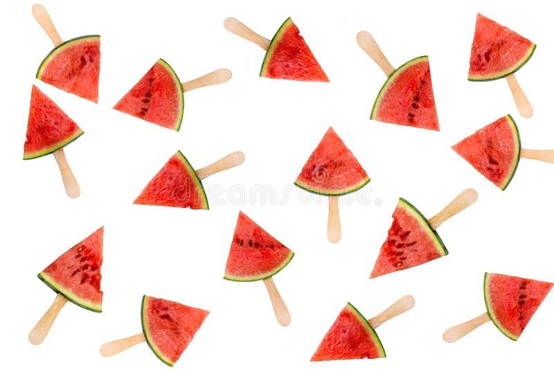 Vele die ijslollys van de watermeloenplak op het witte, verse concept van het de zomerfruit worden geïsoleerd royalty-vrije stock afbeeldingen