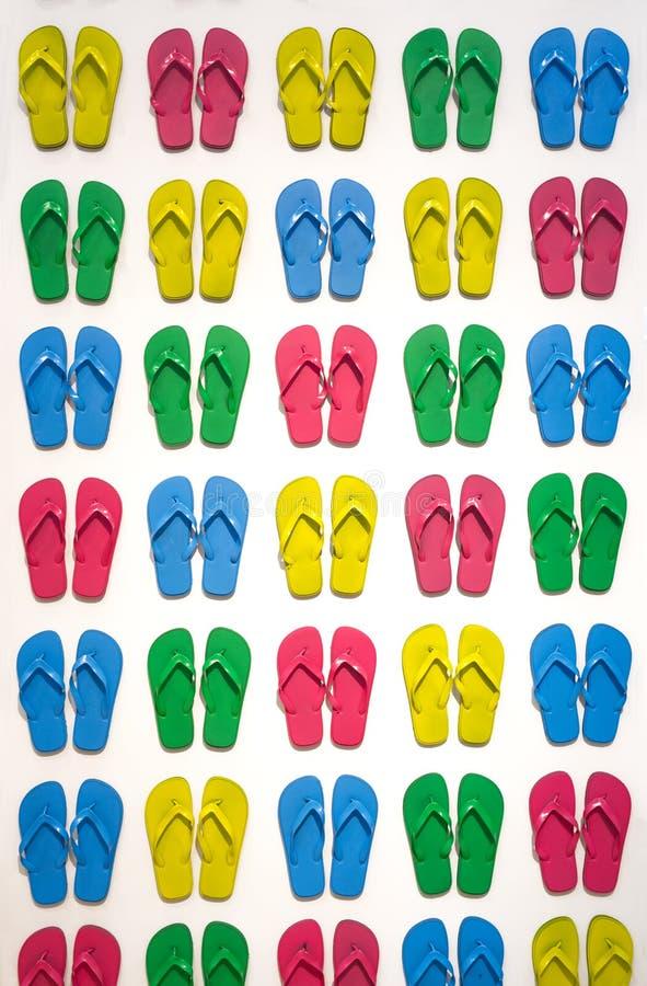 Vele gekleurde pantoffels stock foto