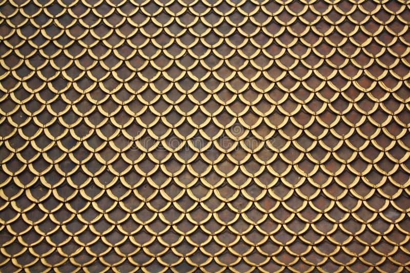 Vele ontwerpen van de daktegel Er zijn gouden en bruine kleuren royalty-vrije stock afbeelding
