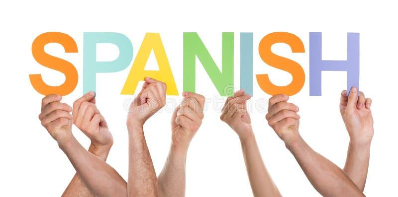Vele Personen die het Woord het Spaans houden stock foto
