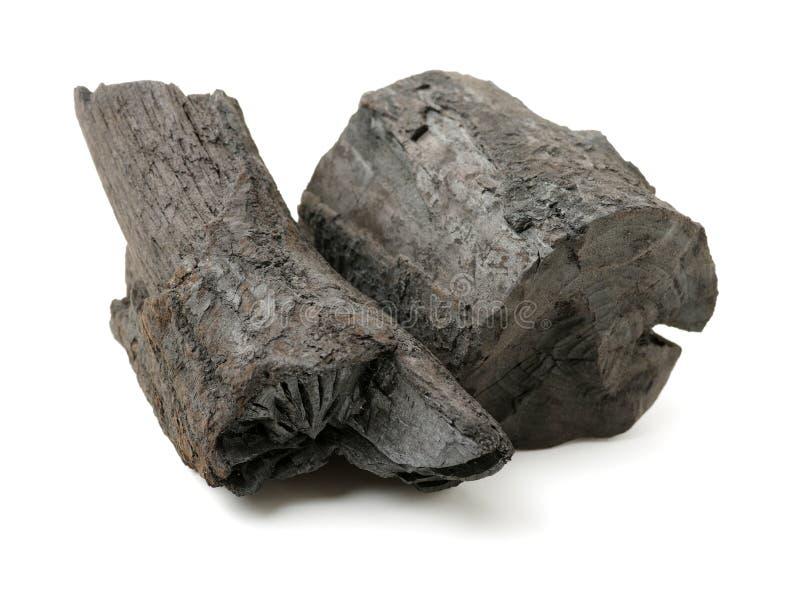 Vele stukken van houtskool stock foto's