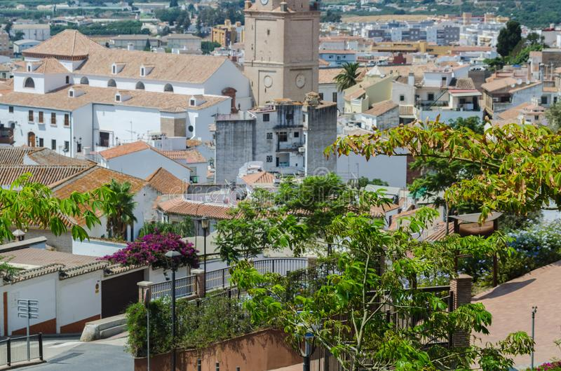 VELEZ-MALAGA, SPAIN - AUGUST 24, 2018 view of buildings in small. VELEZ-MALAGA, SPAIN - AUGUST 24, 2018 roofs and facades of buildings in a Spanish city stock image